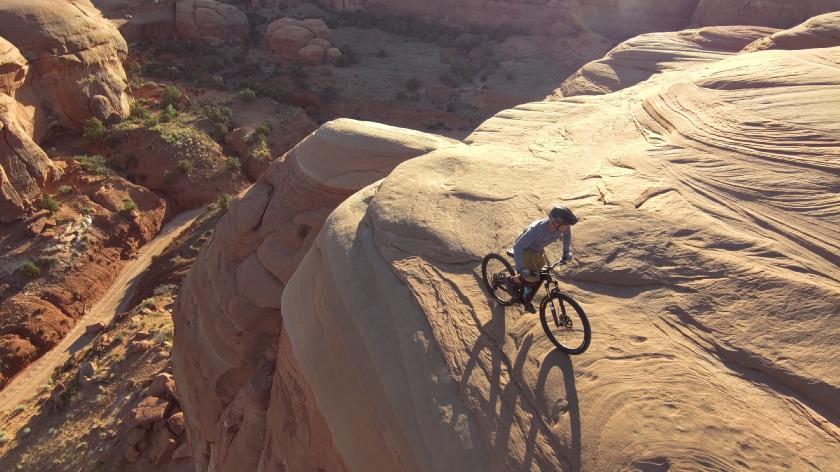 Autonomous Drone aerial photo of mountain biking
