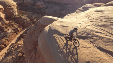 Autonomous Drone aerial photo of mountain biking
