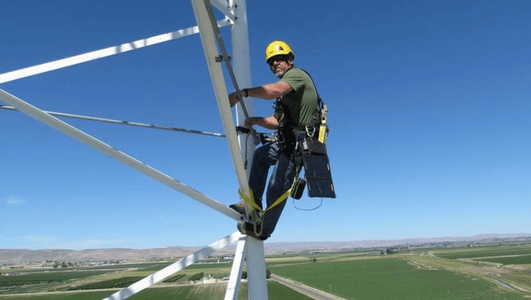 person climbing  transmission electricity tower