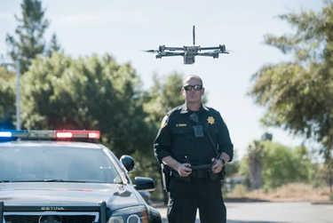 Police officer using drone