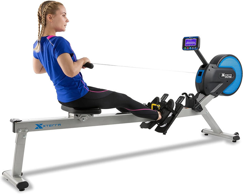 Woman training on magnetic rowing machine from Xterra