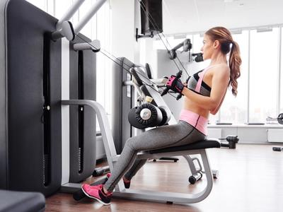 Woman training on home gym machine