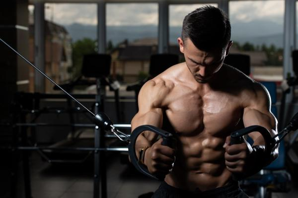 Man working out chest on cable machine