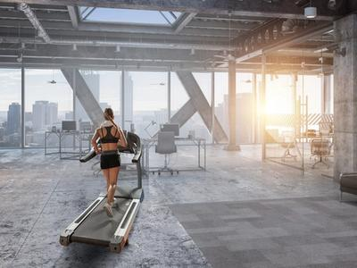 Woman running in her office on a $1000 treadmill.