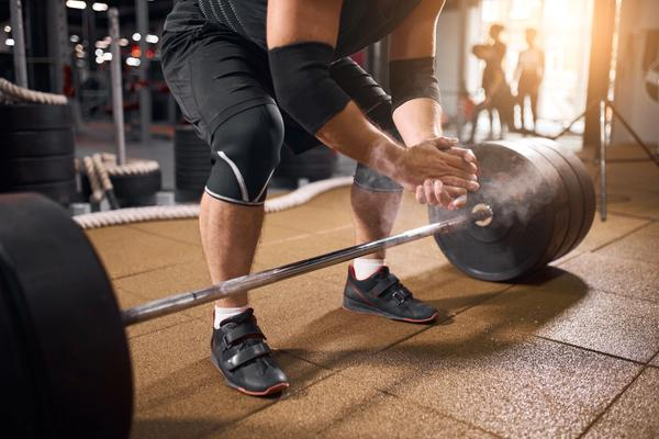 Weight lifter wearing knee sleeves to protect his knees.
