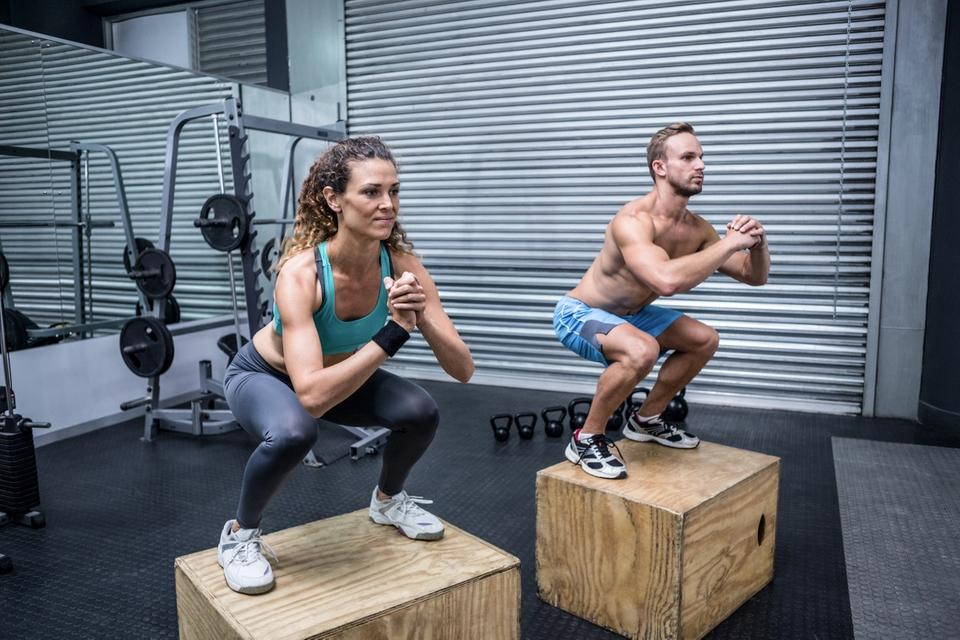 Couple doing CrossFit training using fitness trackers