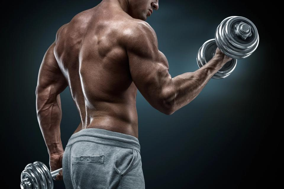 Powerful bodybuilder showing off his rear delts