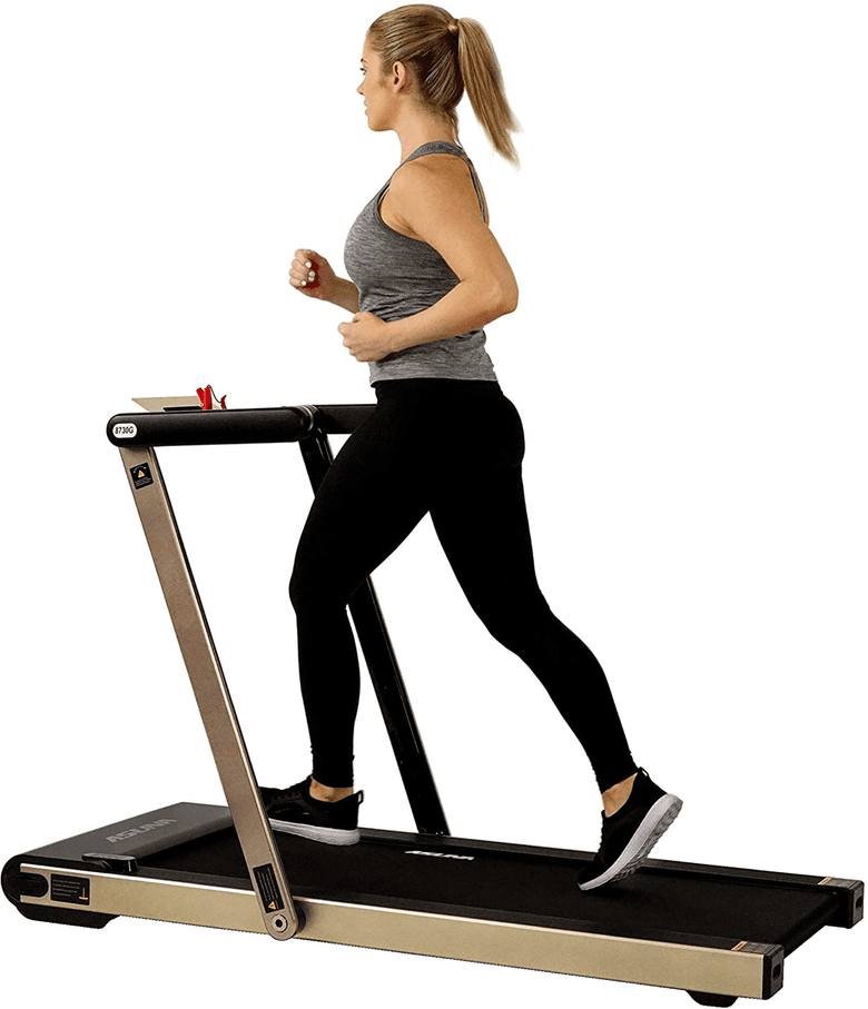 Woman running on the Asuna space saving treadmill