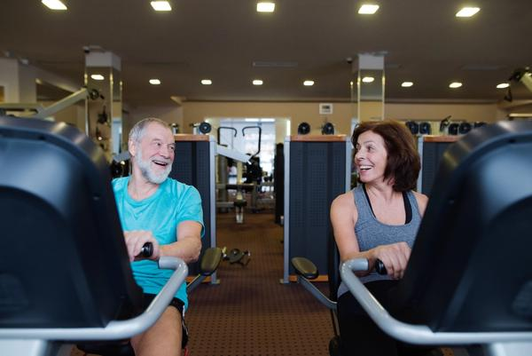 Two seniors working out on recumbent exercise bikes