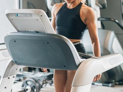 Woman training on manual treadmill