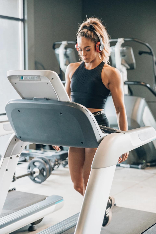 Woman training on manual treadmill