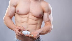 Man taking fat burner pills before working out