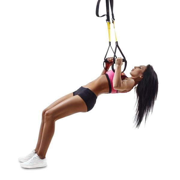 Woman performing Australian pull up on TRX bands