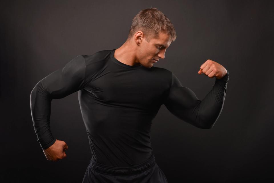 muscular man wearing compression shirt
