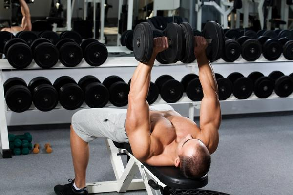 Man working out on a foldable workout bench