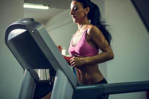 Woman running on affordable treadmill.