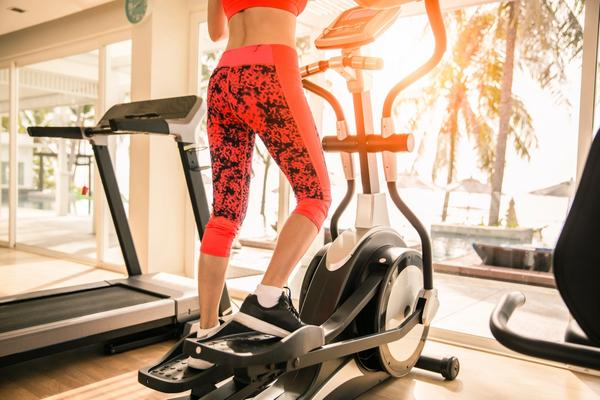 Woman training on a sub-$1000 elliptical machine
