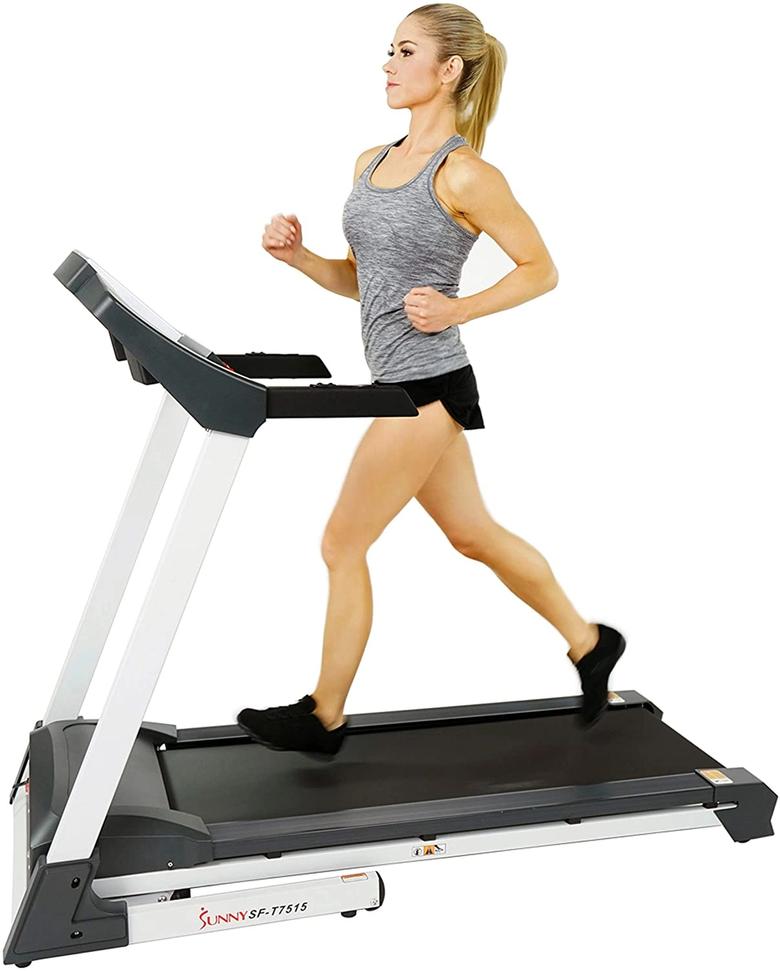 Woman running on Sunny Health & Fitness SF-T7515 treadmill