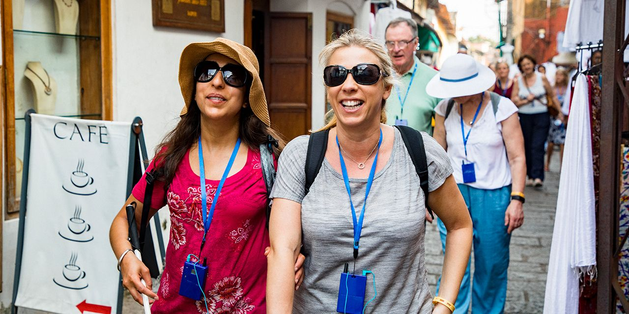 A group of blind tourists on a tour. Photo