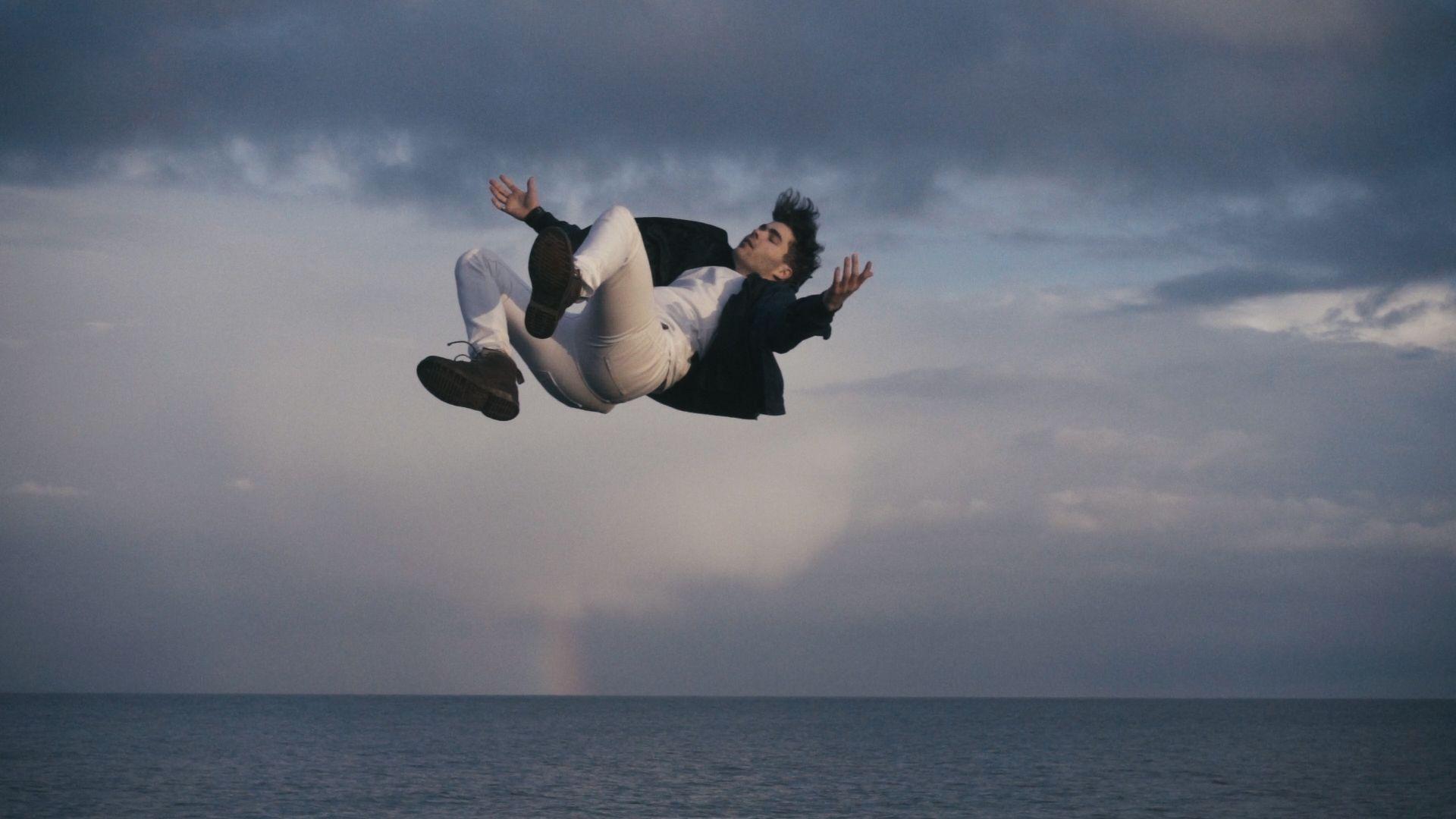 Man falling into sea