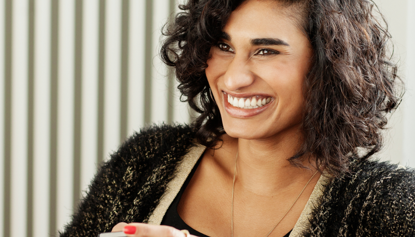 woman smiling holding phone