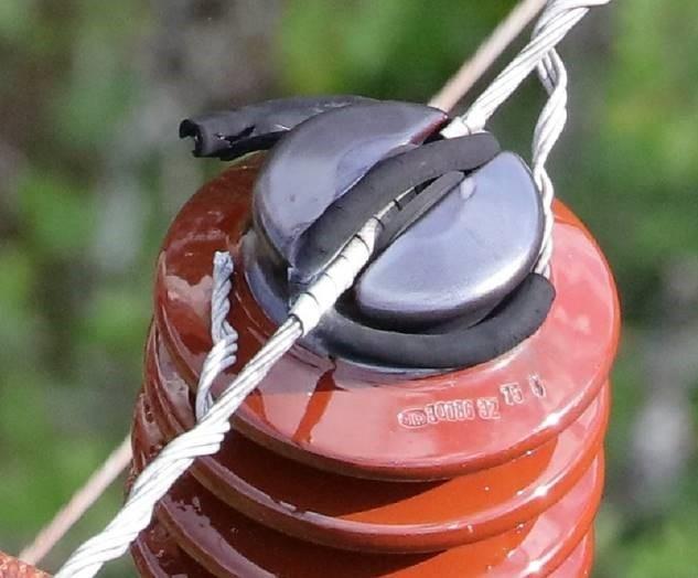 24kV NTP isolator, line 35FeAl, bendslespiral med gummibelagt hylse, beskyttelsesbånd på line i isolatornakke, gummileppe under line i isolatornakke (ikke verifisert)