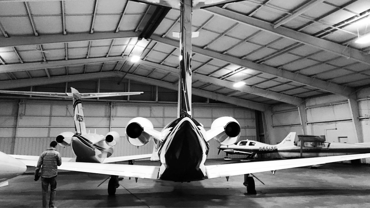 Private aircraft parked in a hangar.