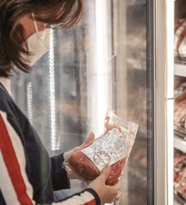 Woman looking at sanitary food label
