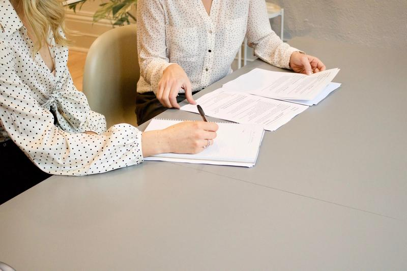 two accountants reviewing business documents