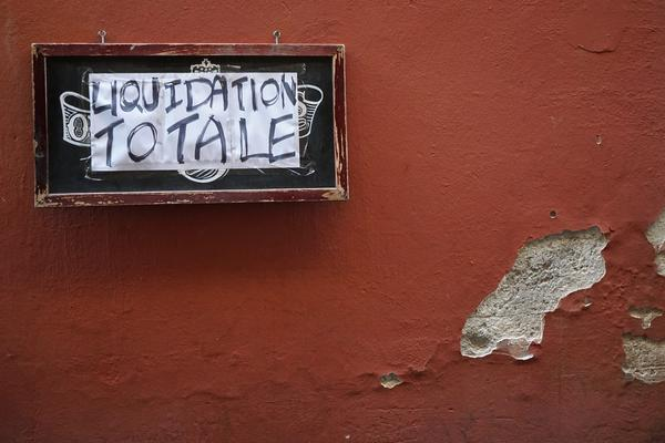 liquidation sign on a wall