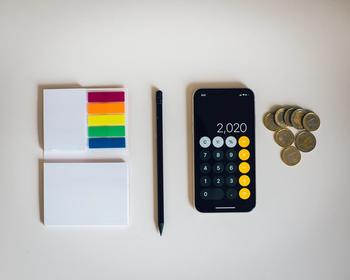 stationary and coins on a desk