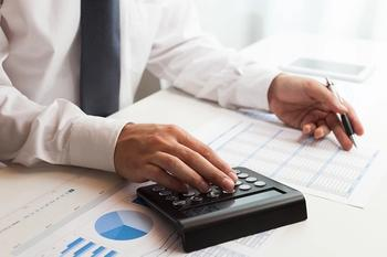 voluntary administrator with a calculator
