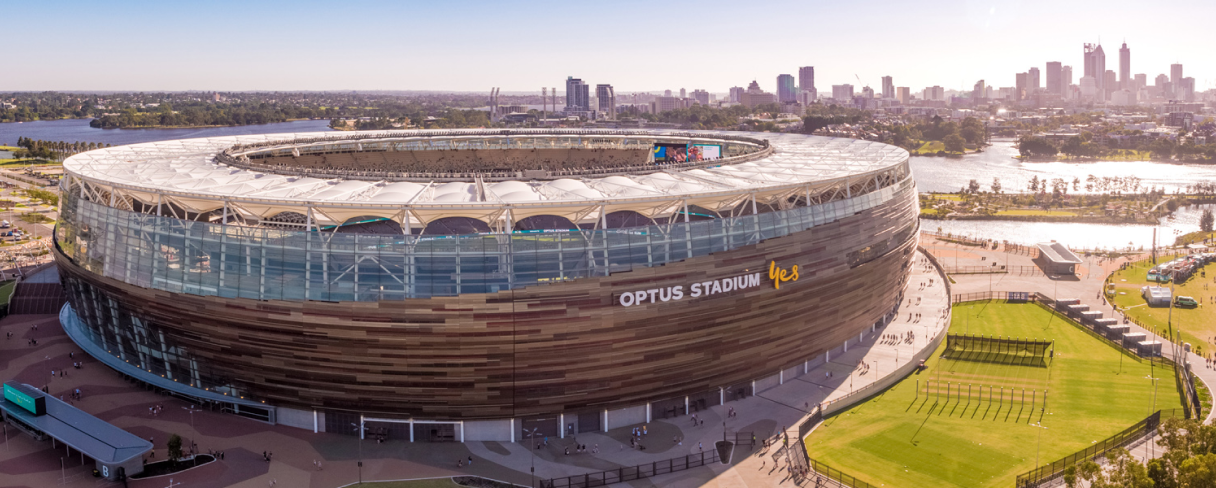 Helicopter image of the Optus stadium with the city in the background