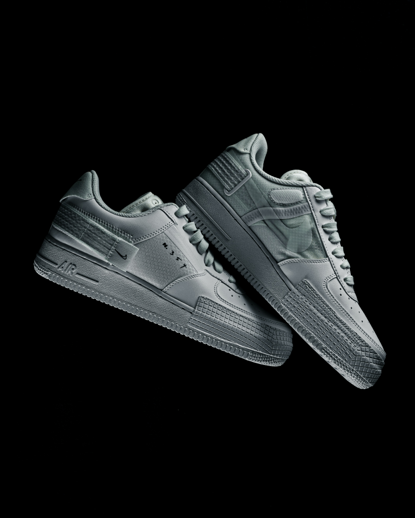 A pair of sneakers on a black background