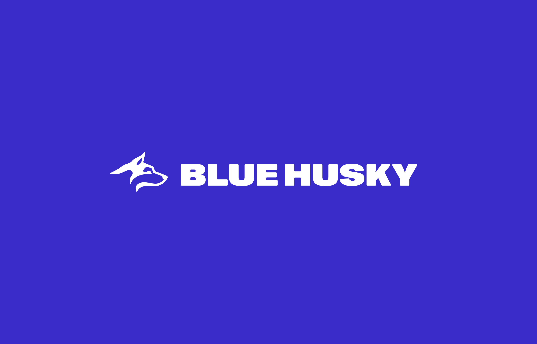 New Blue Husky logo, white text sitting on a vivid blue background