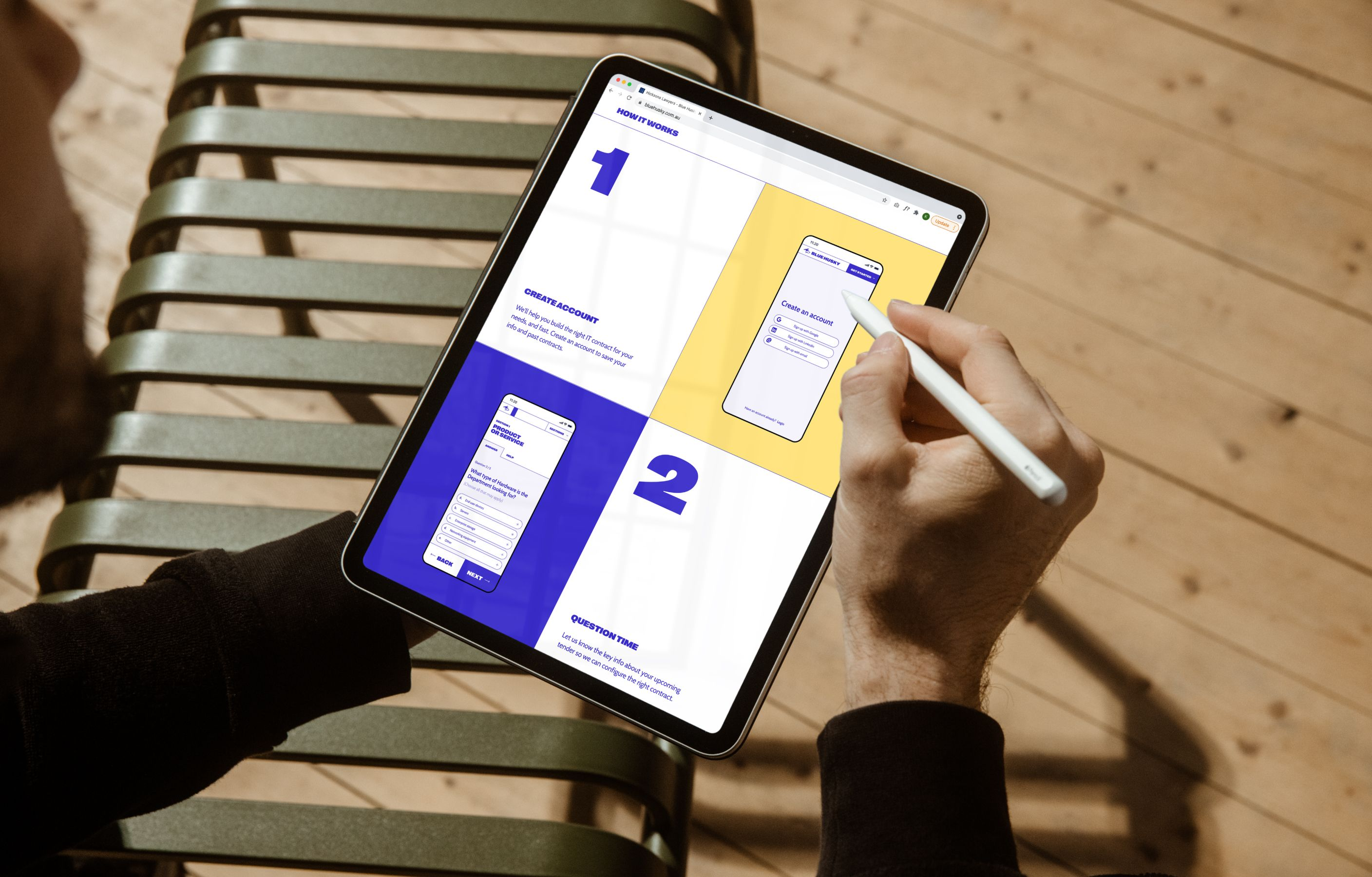 A man on a tablet with a stylus, using the new Blue Husky website