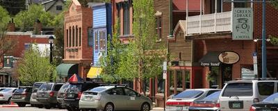 Row of buildings with cars parked outside in downtown Basalt, CO