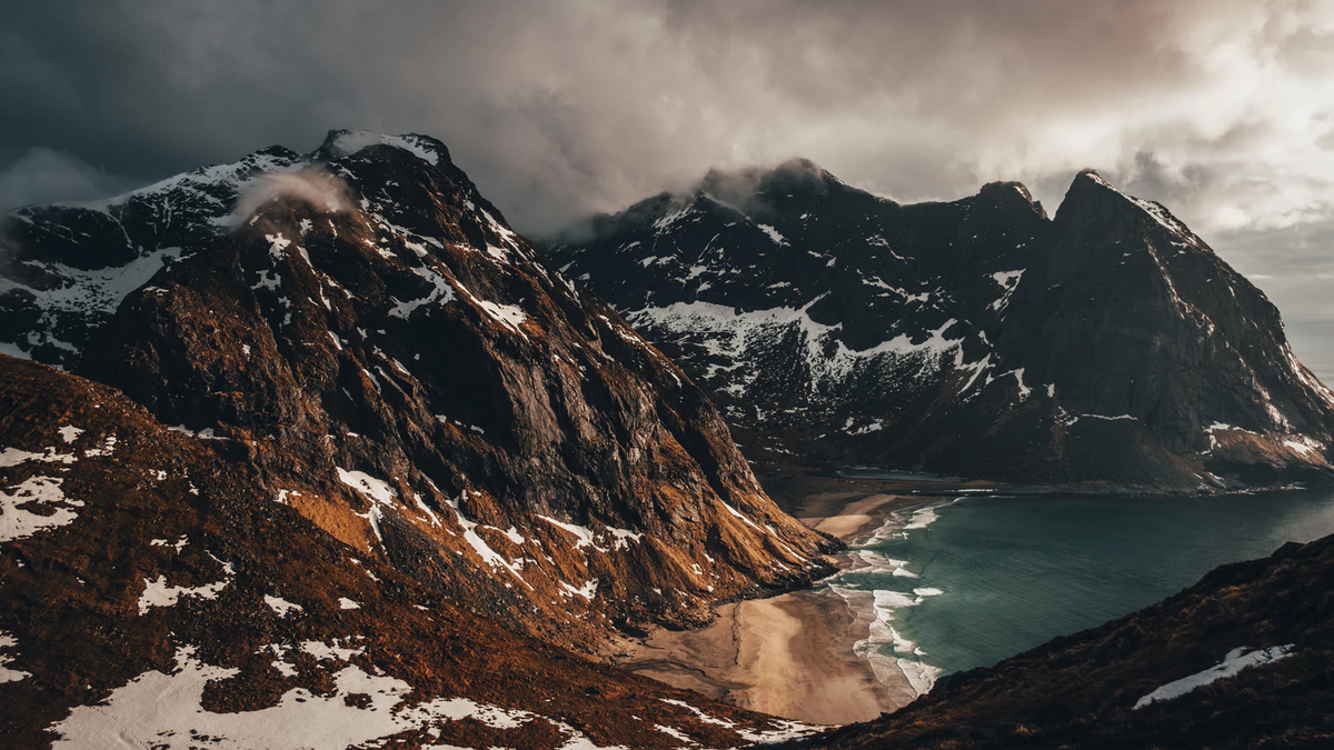 Mountains in cloudly weather with a beach.