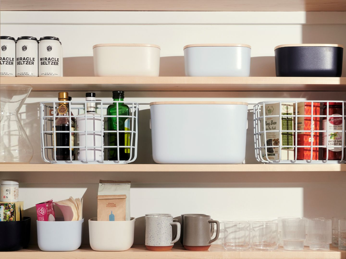 A pantry with various Open Spaces bins and baskets.