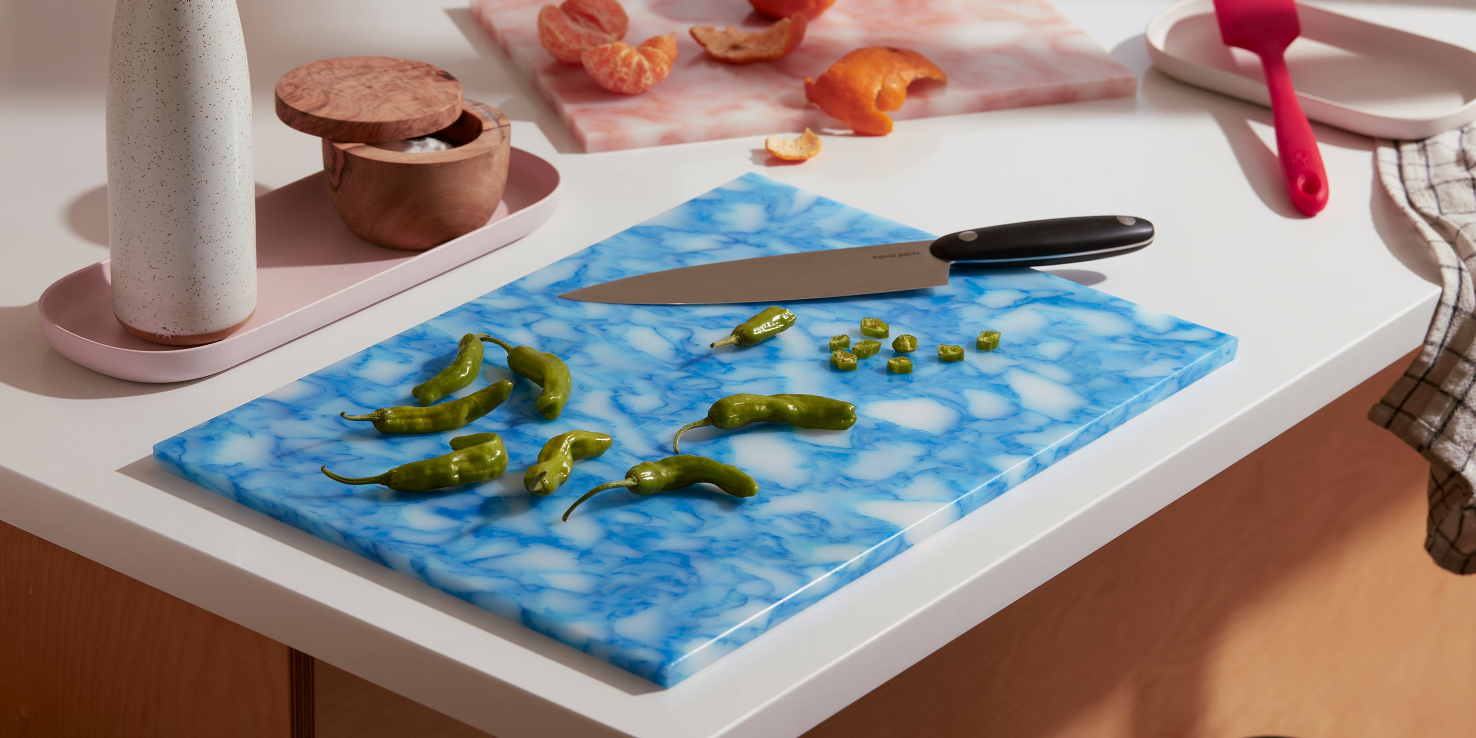 Large Blue Plastic Cutting Board on Counter with EP Chef's Knife