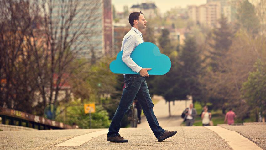 man carrying a cardboard cutout of a cloud