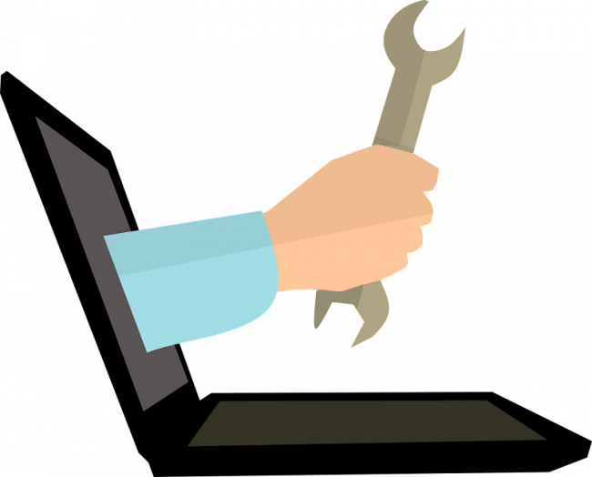 An illustration of a spanner coming out of a laptop to symbolize the concept of learning tools for L&D professionals
