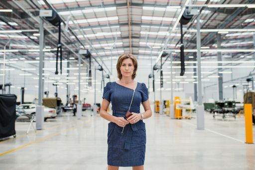 A leader standing alone in a warehouse, a staging that may be suitable for an individualist culture.