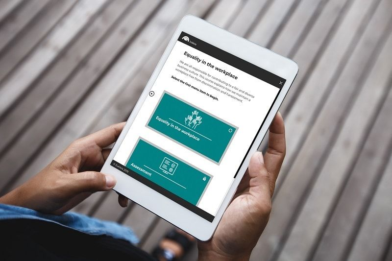 A photo of compliance eLearning on a tablet. This course is responsive and adaptive, displaying perfectly on multiple devices