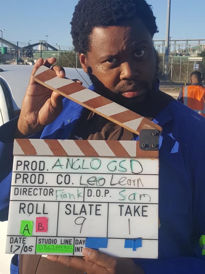 Actor with clapperboard at the beginning of one of the shoots for the Anglo American learning film