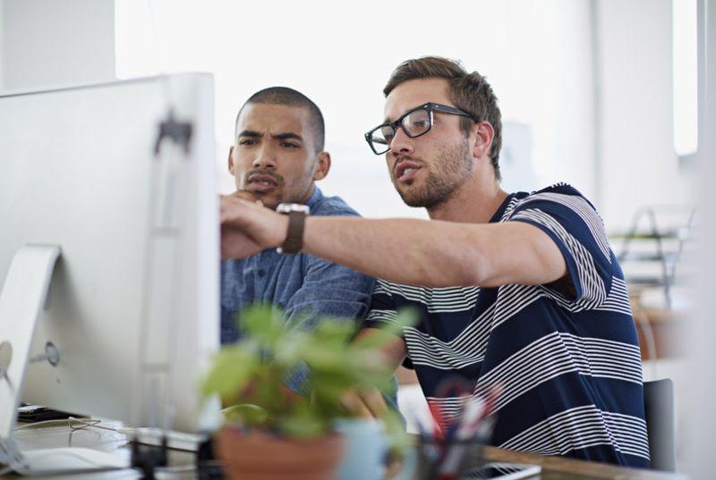 Men using computer to assess their training needs