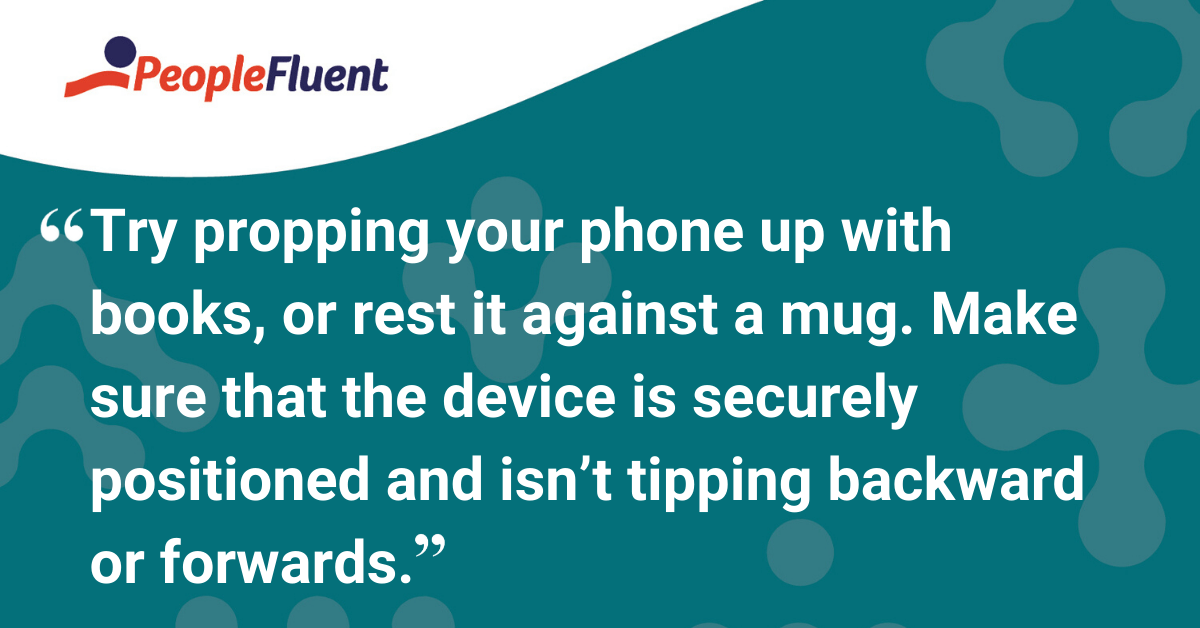 Try propping your phone up with books, or rest it against a mug. Make sure that the device is securely positioned and isn't tipping backward or forwards.