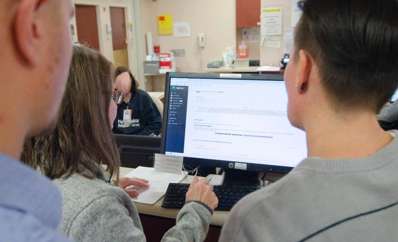 Employees enter data into their checklist observation tool.