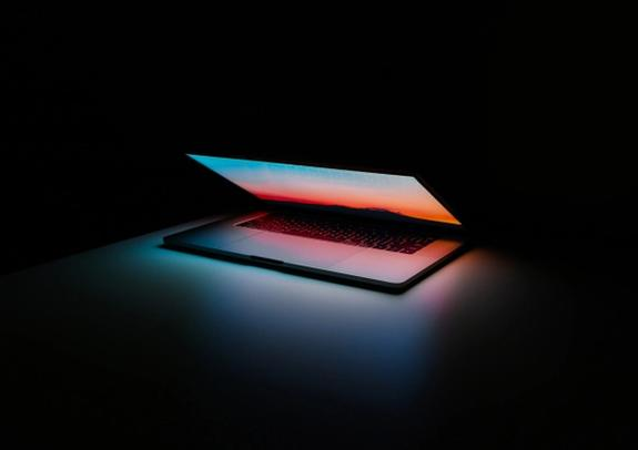 Photo of a PC in a dark room