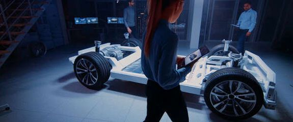 People standing in front of a futuristic car